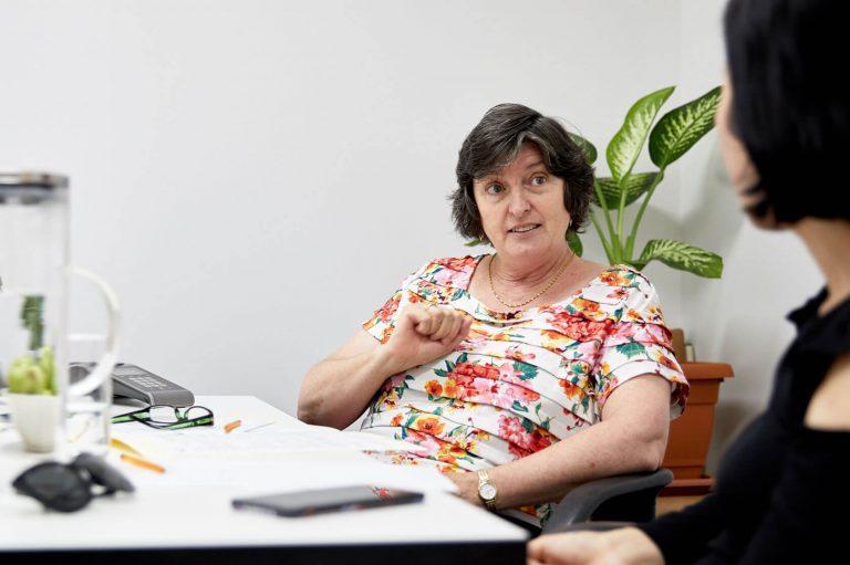 Two ladies talking in the Kin office