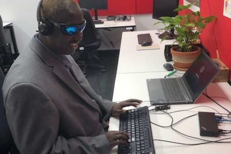 Systemic Advocate, Dr Siyat Abdi working on his computer